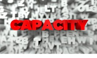 CAPACITY -  Red text on typography background - 3D rendered royalty free stock image. This image can be used for an online website banner ad or a print postcard.